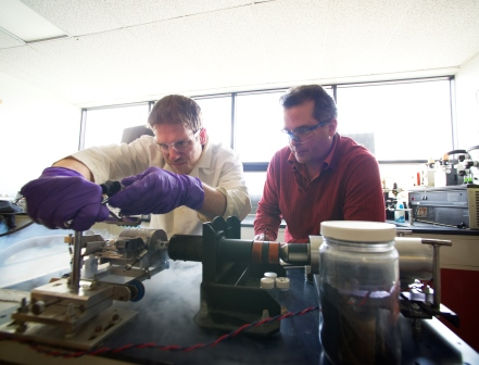 student and professor in lab