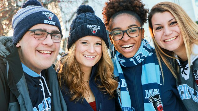Four students in winter clothing.