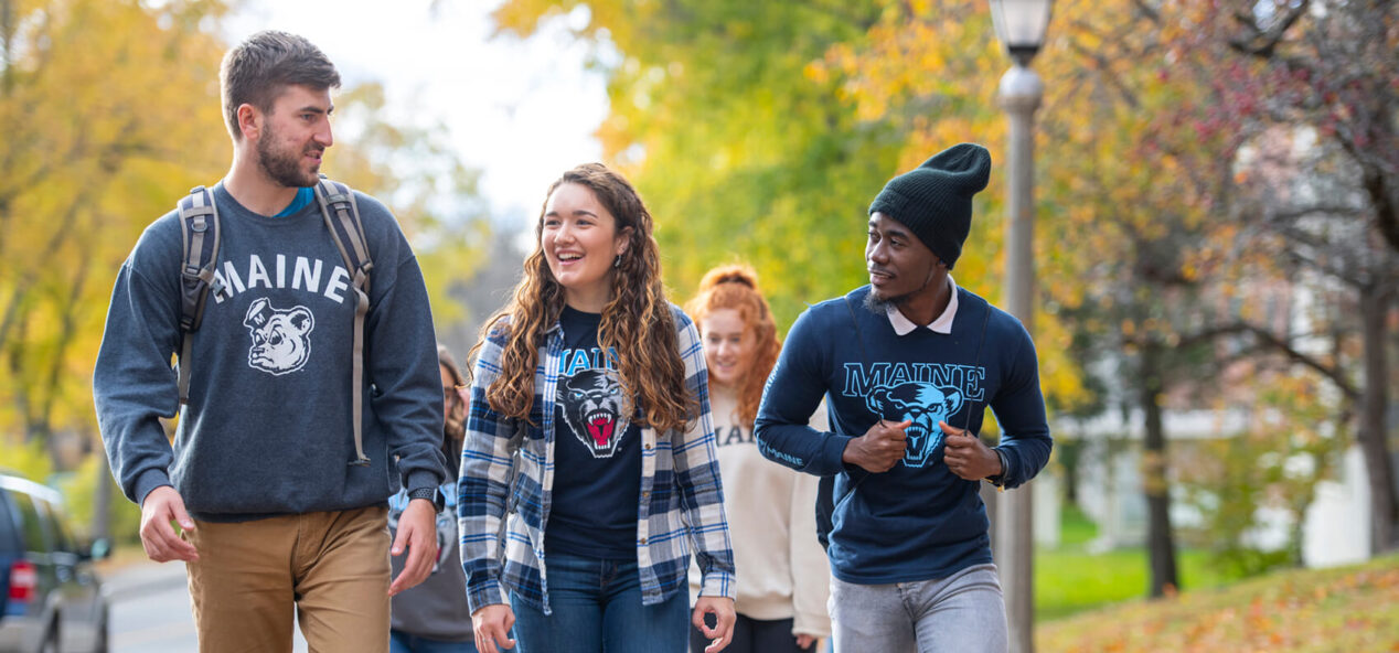 Male and female students walking to class