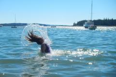Student enjoying a swim in the ocean