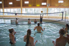Students playing Volleyball in our Recreation Center Pool