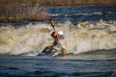 A student whitewater kayaking