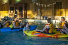 Students kayaking in our Campus Recreation Pool
