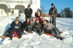 Students enjoying sledding on a beautiful winter day